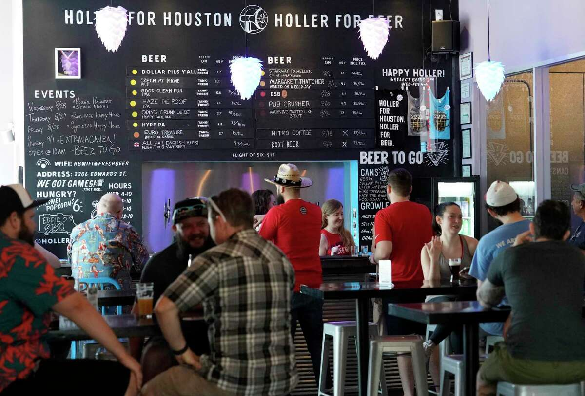People drink beer at Holler Brewing Co., 2206 Edwards St., Sunday, Sept. 1, 2019, in Houston. Texas became the final state in the country to legalize take-home sales from manufacturing breweries as the result of a law passed during the 2019 Texas legislative session. With the new law, beer can be sold at 10 a.m. instead of noon on Sundays.