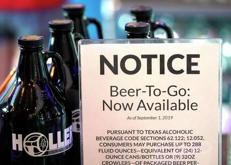 A sign about beer-to-go is display along with growler bottles at Holler Brewing Co., 2206 Edwards St., Sunday, Sept. 1, 2019, in Houston. Texas became the final state in the country to legalize take-home sales from manufacturing breweries as the result of a law passed during the 2019 Texas legislative session.With the new law, beer can be sold at 10 a.m. instead of noon on Sundays.