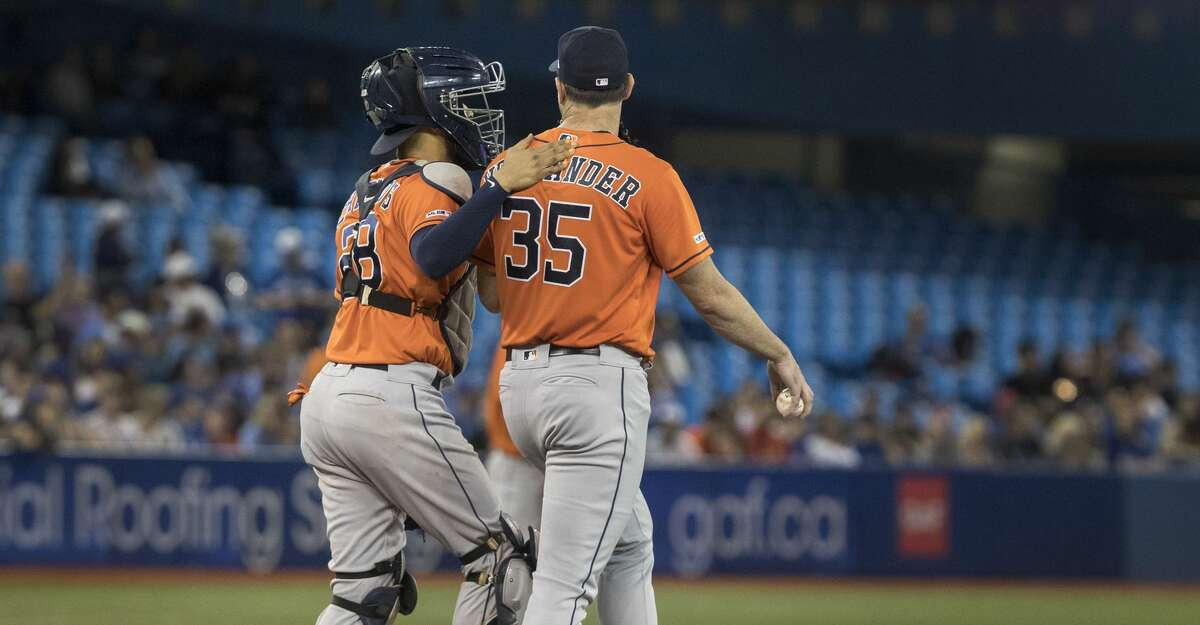 Houston Astros starting pitcher Justin Verlander (35) walks up the mound with catcher Robinson Chirinos before facing the last hitter, Toronto Blue Jays' Bo Bichette, in the ninth inning of a baseball game in Toronto, Sunday, Sept. 1, 2019. (Fred Thornhill/The Canadian Press via AP)