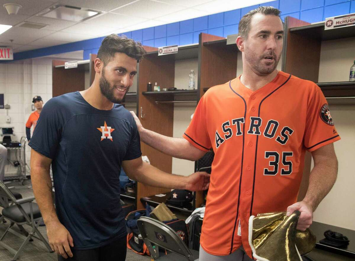 The Astros' postgame clubhouse was a happy place for Abraham Toro, left, and Justin Verlander.