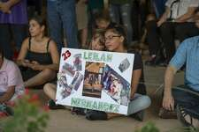 Celeste Lujan, left, and Yasmin Natera hold a sign for shooting victim Leilah Hernandez during a vigil Sunday, Sept. 1, 2019 at the University of Texas of the Permian Basin.