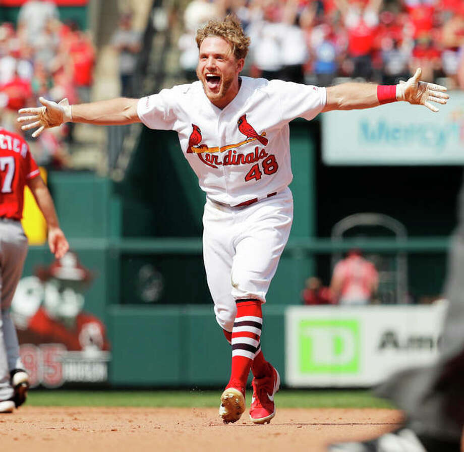 The Cardinals' Harrison Bader celebrates after hitting a walk-off single to defeat the Reds in the first of two games Sunday at Busch Stadium. Photo: Associated Press