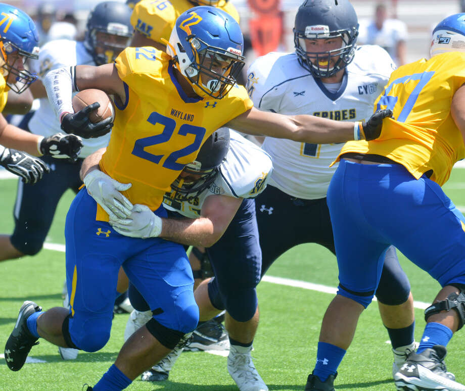 Wayland Baptist's Christian Vaughn attempts to avoid the tackle from the Saint Mary defender as teammate Austin Tarin blocks up field during their NAIA football season opener on Saturday afternoon in Greg Sherwood Memorial Bulldog Stadium. Photo: Nathan Giese/Planview Herald