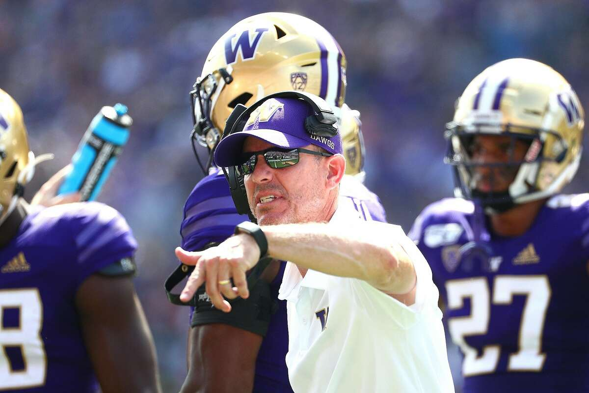 SEATTLE, WASHINGTON - AUGUST 31: Head Coach Chris Petersen of the Washington Huskies signals to team members in the first quarter against the Eastern Washington Eagles during their game at Husky Stadium on August 31, 2019 in Seattle, Washington. (Photo by Abbie Parr/Getty Images)