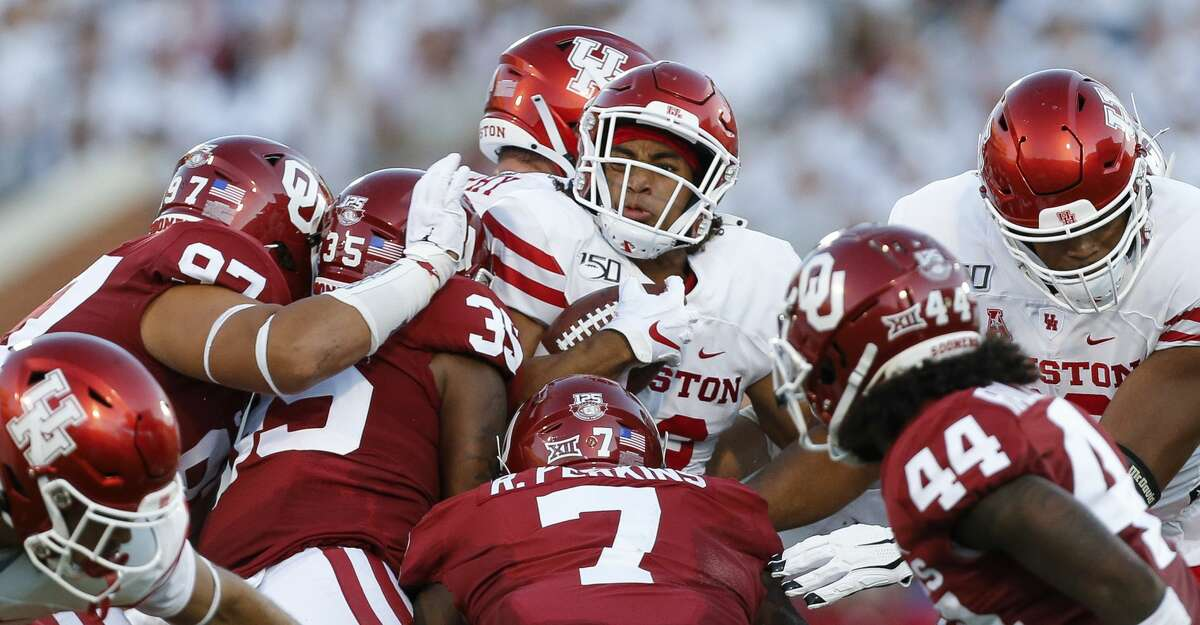 Houston Cougars running back Kyle Porter (22) is tackled by Oklahoma Sooners defenders during the second quarter of an NCAA game at Gaylord Memorial Stadium Sunday, Sept. 1, 2019, in Norman, Oklahoma.