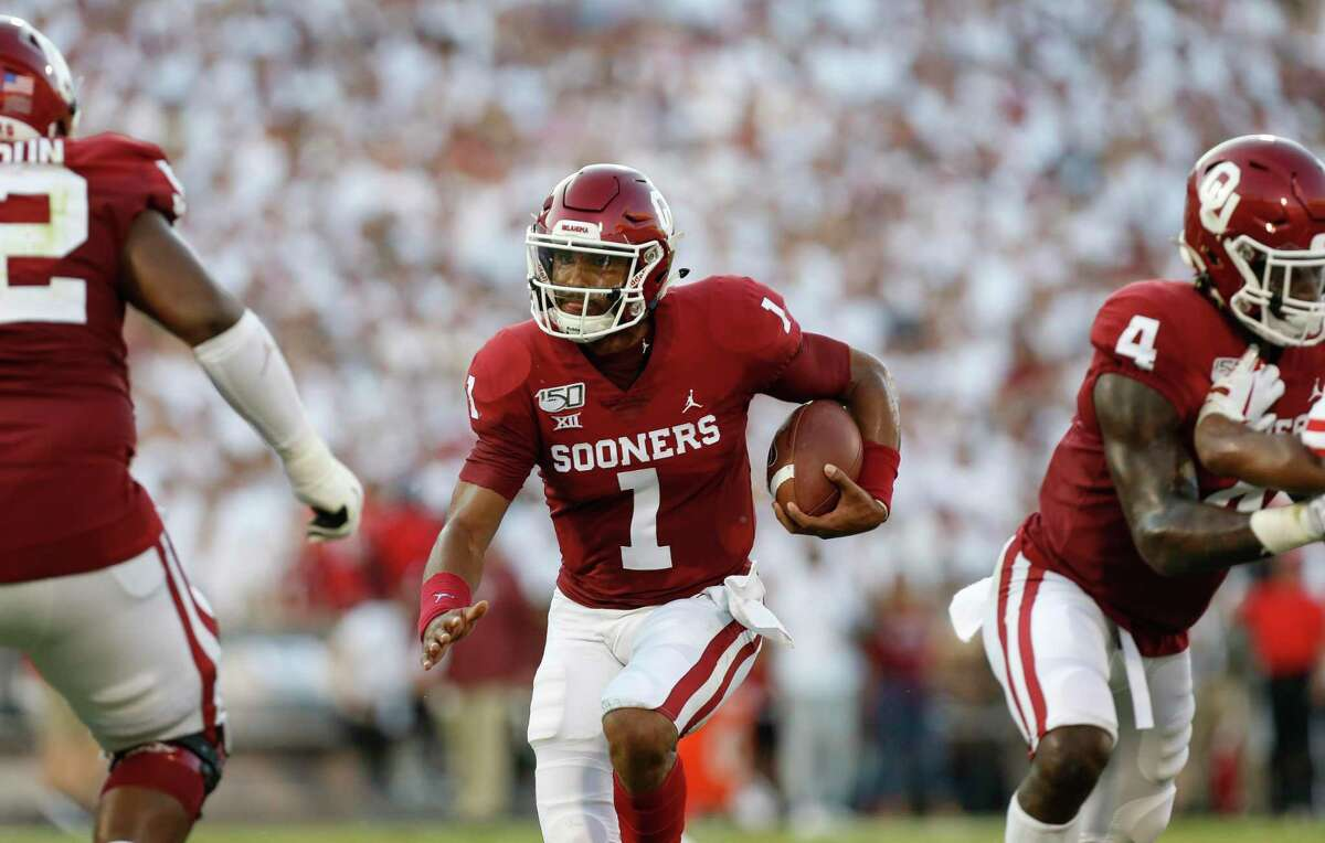 Oklahoma quarterback Jalen Hurts passed for 174 yards and two touchdowns and had 128 yards and another TD on 11 carries ... in the first half.