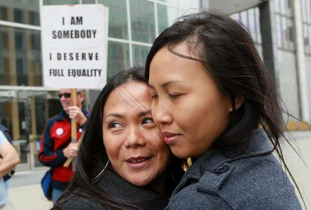 SAN FRANCISCO - AUGUST 04:  Same-sex couple Maria Ydil (L) and Vanessa Judicpa embrace as they wait to hear the ruling on Prop 8 outside of the Philip Burton Federal building  August 4, 2010 in San Francisco, California.US District Judge Vaughn Walker announced his ruling to overturn Prop 8 finding it unconstitutional. The voter approved measure denies same-sex couples the right to marry in the State of California.  (Photo by Justin Sullivan/Getty Images) *** Local Caption *** Vanessa Judicpa;Maria Ydil Photo: Justin Sullivan, Getty Images / 2010 Getty Images