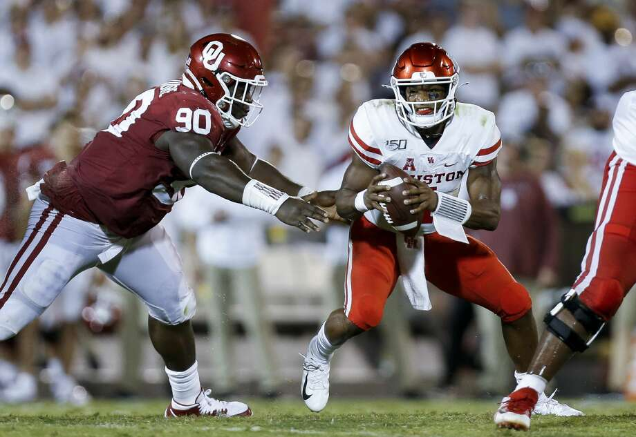 PHOTOS: D'Eriq King in action against Oklahoma Houston Cougars quarterback D'Eriq King (4) avoids the pressure by Oklahoma Sooners defensive lineman Neville Gallimore (90) during the fourth quarter of an NCAA game at Gaylord Memorial Stadium Sunday, Sept. 1, 2019, in Norman, Oklahoma. The Sooners won 49-31. Photo: Godofredo A Vásquez