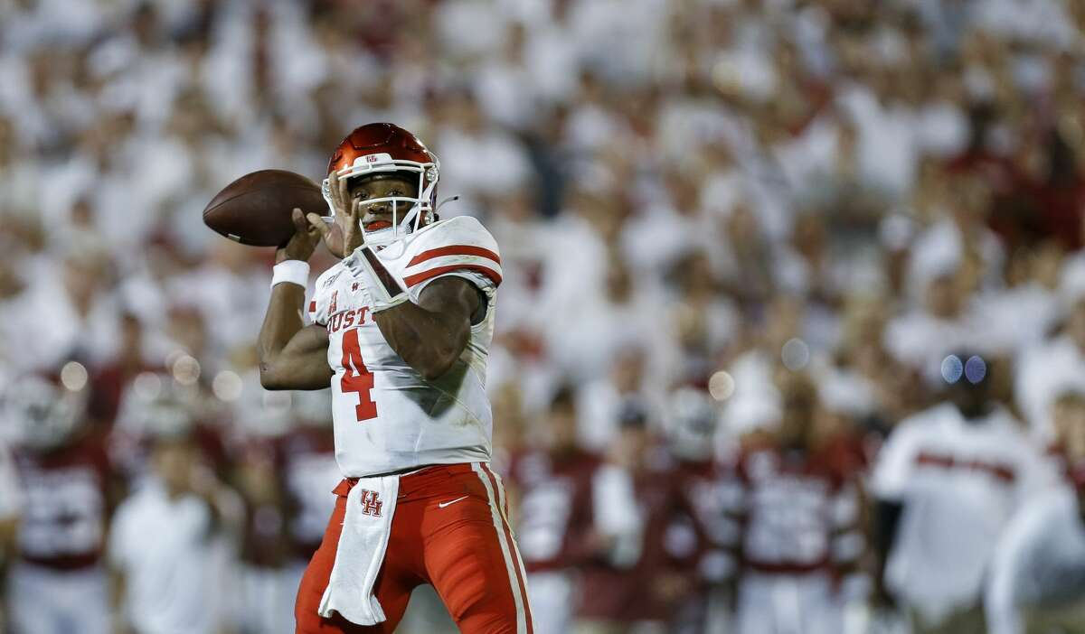 Houston Cougars quarterback D'Eriq King (4) throws a touchdown to wide receiver Marquez Stevenson (5) against the Oklahoma Sooners during the fourth quarter of an NCAA game at Gaylord Memorial Stadium Sunday, Sept. 1, 2019, in Norman, Oklahoma. The Sooners won 49-31.