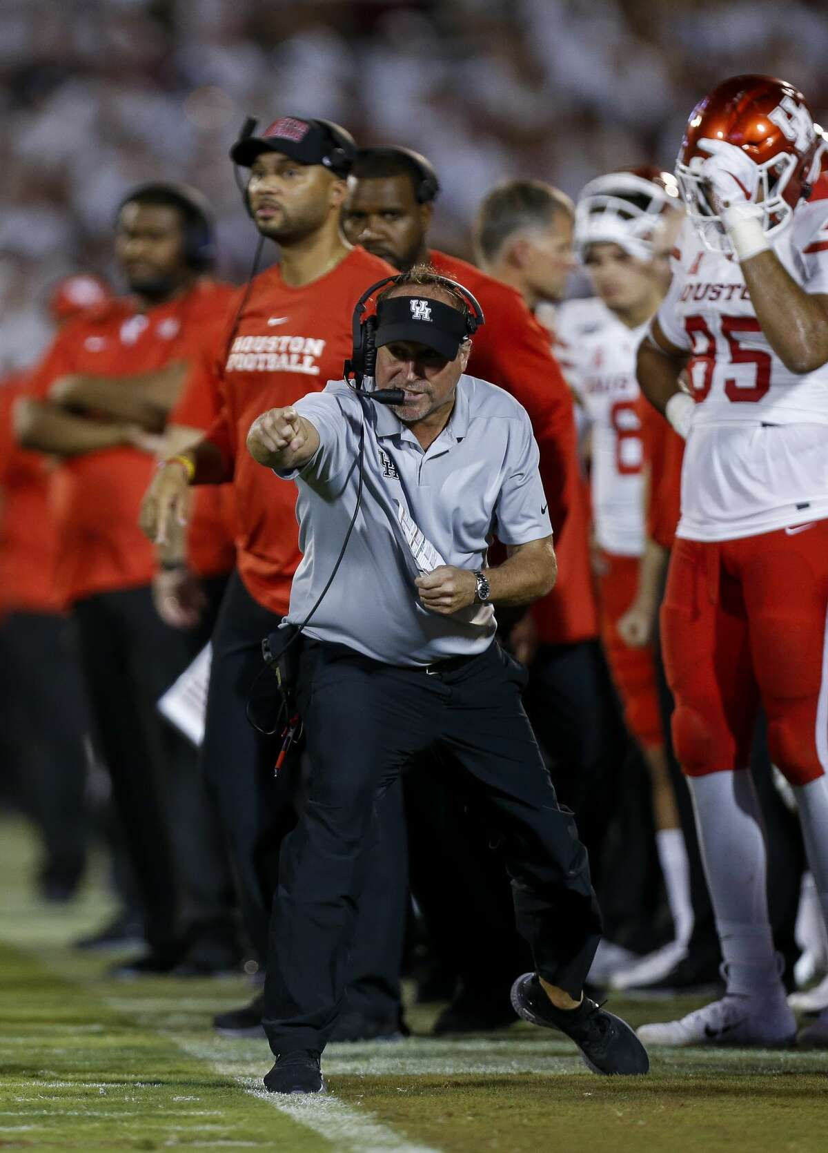 Houston Cougars head coach Dana Holgorsen signals a play from the sideline against the Oklahoma Sooners during the fourth quarter of an NCAA game at Gaylord Memorial Stadium Sunday, Sept. 1, 2019, in Norman, Oklahoma. The Sooners won 49-31.