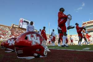 Houston Cougars players warm up before an NCAA game against the Oklahoma Sooners at Gaylord Memorial Stadium Sunday, Sept. 1, 2019, in Norman.