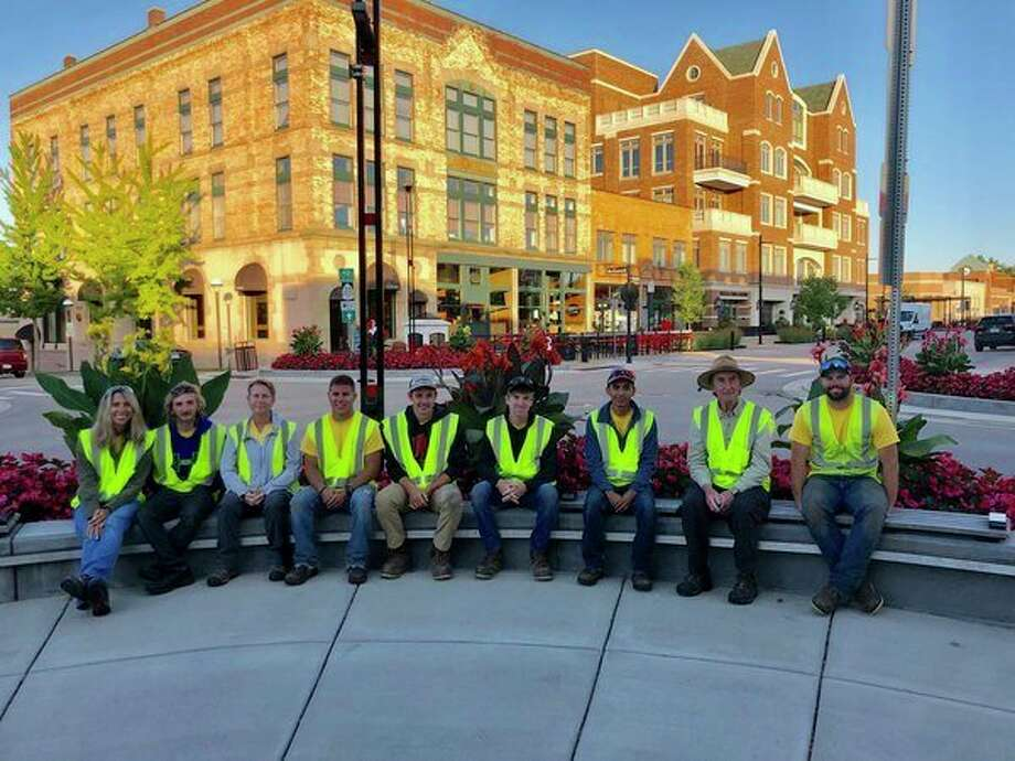 MIdland horticulture crew members are, from left: Carie LeFevre, Travis Rickett, Marcia Doring, Chandler Stoutenburg, Benjamin Matzke, Jacob Beck, Noe Solorio, Randy McDonald and Adam Fitzgibbon. (Lindsay Henry Rohde/for the Daily News)