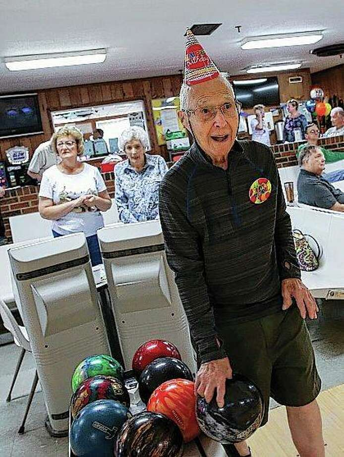 Larry Vakoc celebrates his 100th birthday by bowling at Wood Dale Bowl in Wood Dale. As unusual as it is for golfers to shoot their age, it's more rare for a 100-year-old bowler to roll his age. But Larry Vakoc does it all the time. Photo: Bev Horne | Daily Herald (AP)