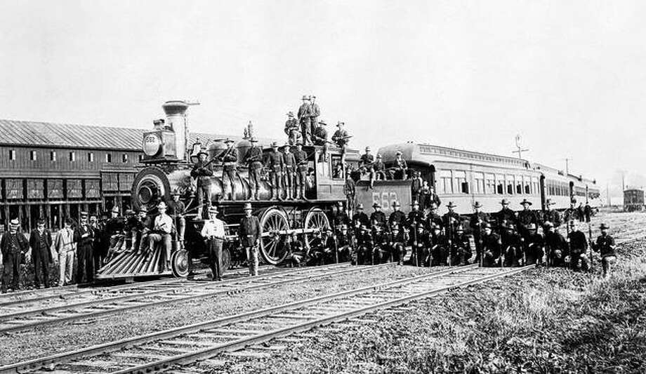 Members of the 15th U.S. Infantry Co. C, called in by President Cleveland to help break up a railroad strike against the Pullman Palace Car Co., pose beside a special Rock Island Railroad patrol train. Photo: Chicago History Museum | Getty Images