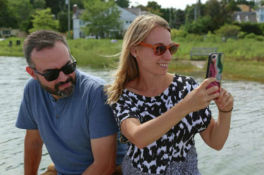 Rob and Christie Petrone of Brooklyn, N.Y., enjoy a day in the country for the Hummock Island Oyster Tour on Saturday, Aug. 31, 2019, in Westport, Conn. Photo: Jarret Liotta / Jarret Liotta / ©Jarret Liotta
