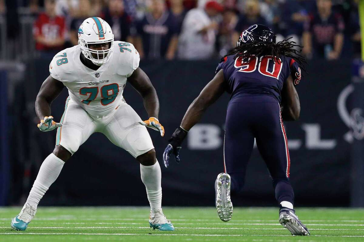 In a pair of major trades Saturday, the Texans traded Jadeveon Clowney (90) to Seattle for a widely panned return while giving up two first-round picks and a second-rounder for Laremy Tunsil (left), shoring up the left-tackle problem that's lingered since they jettisoned Duane Brown.