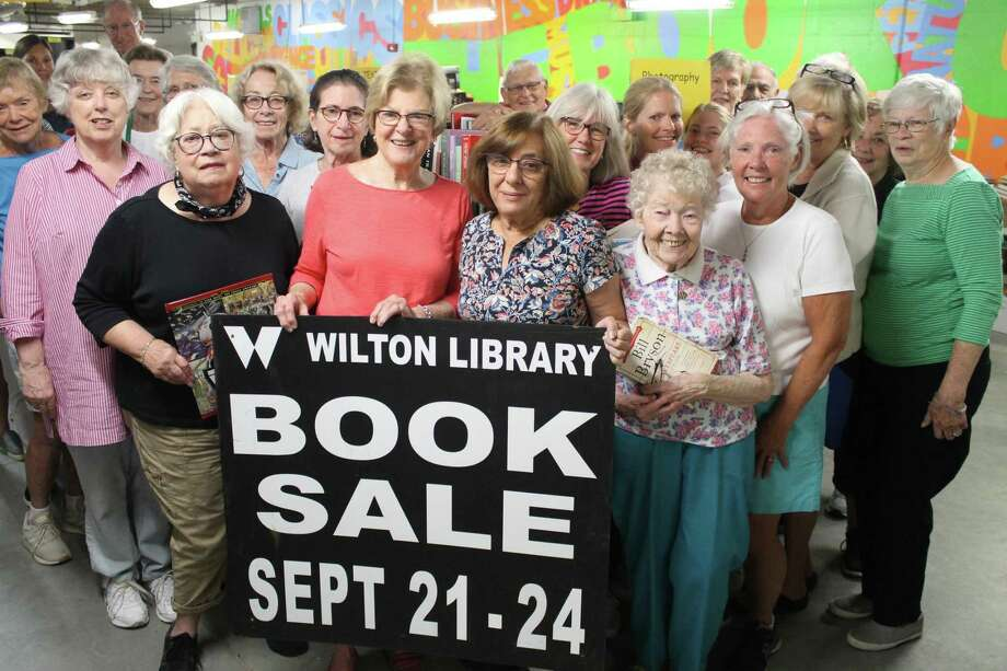 Wilton Library volunteers prepare for the Awesome Autumn Book Sale that will take place Sept. 21-24, 2019 at the library in Wilton, Conn. Photo: Contributed Photo / Wilton Library / Wilton Bulletin