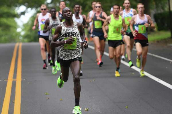 Defending champion Leonard Korir uses a downhill to break away from the lead pack on his way to winning his third Faxon Law New Haven Road Race in New Haven, Conn. on Monday, September 2, 2019.