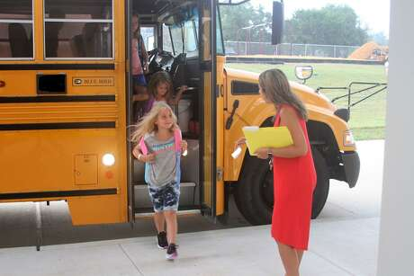 Elementary students get off the bus at the new Coldspring Intermediate Bus Loop on the first day of school, Aug. 26.