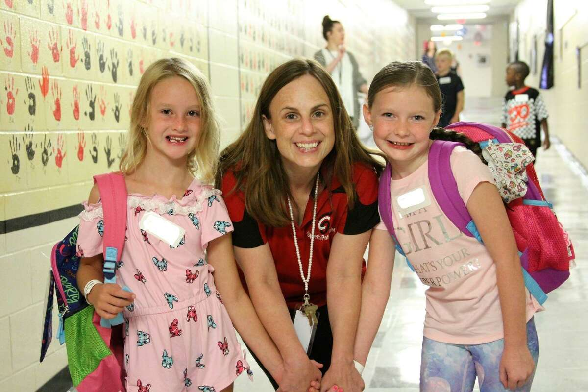 COCISD Speech Pathologist Heather Manly welcomed two elementary students on their first day of the new school year, Monday, Aug. 26.