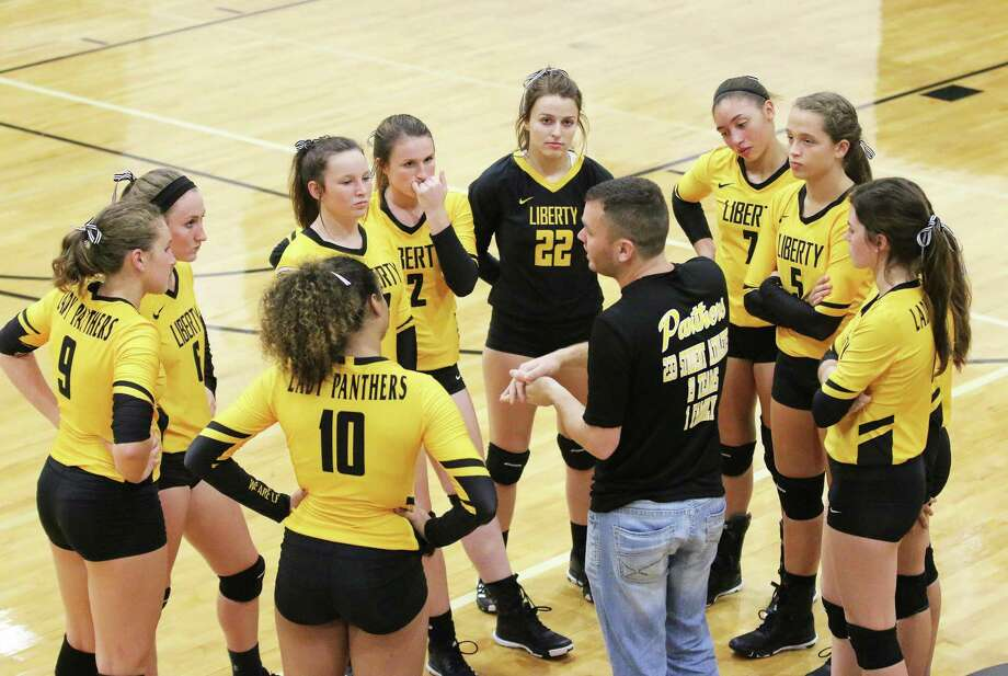 Head Volleyball Coach Glenn Kennedy talks to his team during a timeout in last Friday night's game against Corrigan-Camden. Kennedy challenged his team to not be complacent. Photo: David Taylor / HCN