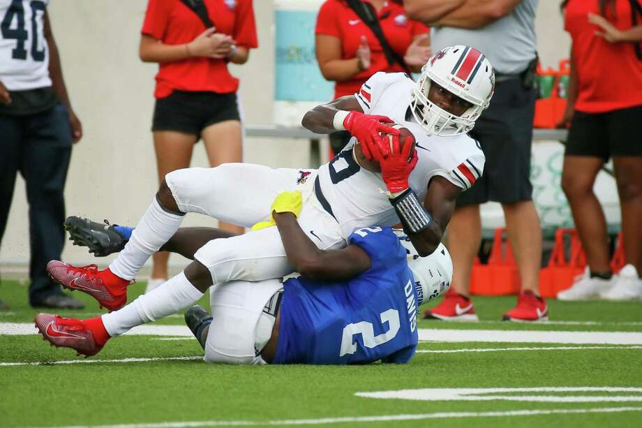 Katy Taylor defensive back Lee Davis tackles Atascocita Eagles wide receiver AJ Bobb during the high school football game between the Atascocita Eagles and Katy Taylor Mustangs at Legacy Stadium in Katy, Texas on August 30, 2019. Photo: Leslie Plaza Johnson, Freelancer / Contributor / Houston Chronicle