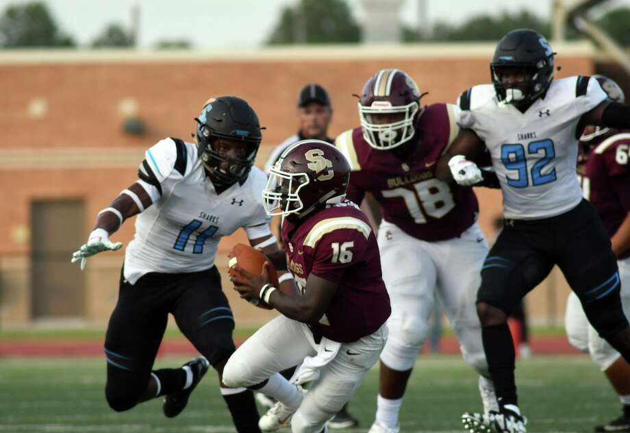 Shadow Creek senior linebacker Jeremiah Harris (11) chases Summer Creek junior quarterback Bryan Bush (16) while Bush's teammate Kelvin Banks (78) tries to hold his block on the Sharks Alec Bryant (92) in the first quarter of their non-district season opener at Turner Stadium in Humble on August 31, 2019. Photo: Jerry Baker, Houston Chronicle / Contributor / Houston Chronicle