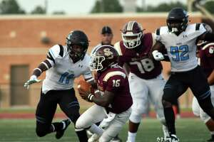Shadow Creek senior linebacker Jeremiah Harris (11) chases Summer Creek junior quarterback Bryan Bush (16) while Bush's teammate Kelvin Banks (78) tries to hold his block on the Sharks Alec Bryant (92) in the first quarter of their non-district season opener at Turner Stadium in Humble on August 31, 2019.