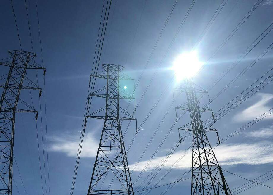 The state's grid manager asked consumers and businesses to reduce their electricity use on Thursday and Friday, especially during 2 p.m. and 7 p.m., as high heat and record breaking demand are expected to strain electricity supplies.  Photo: Bill Montgomery / Houston Chronicle