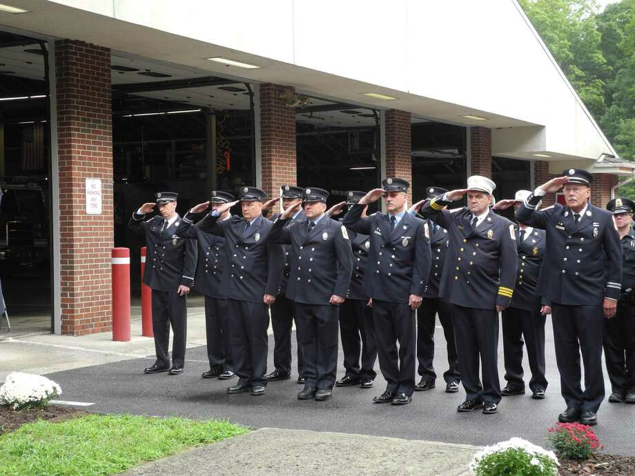 Members of the Wilton Fire Department salute during last year's Sept. 11 remembrance ceremony held on Sept. 11, 2018. Photo: Jeannette Ross / Hearst Connecticut Media / Wilton Bulletin