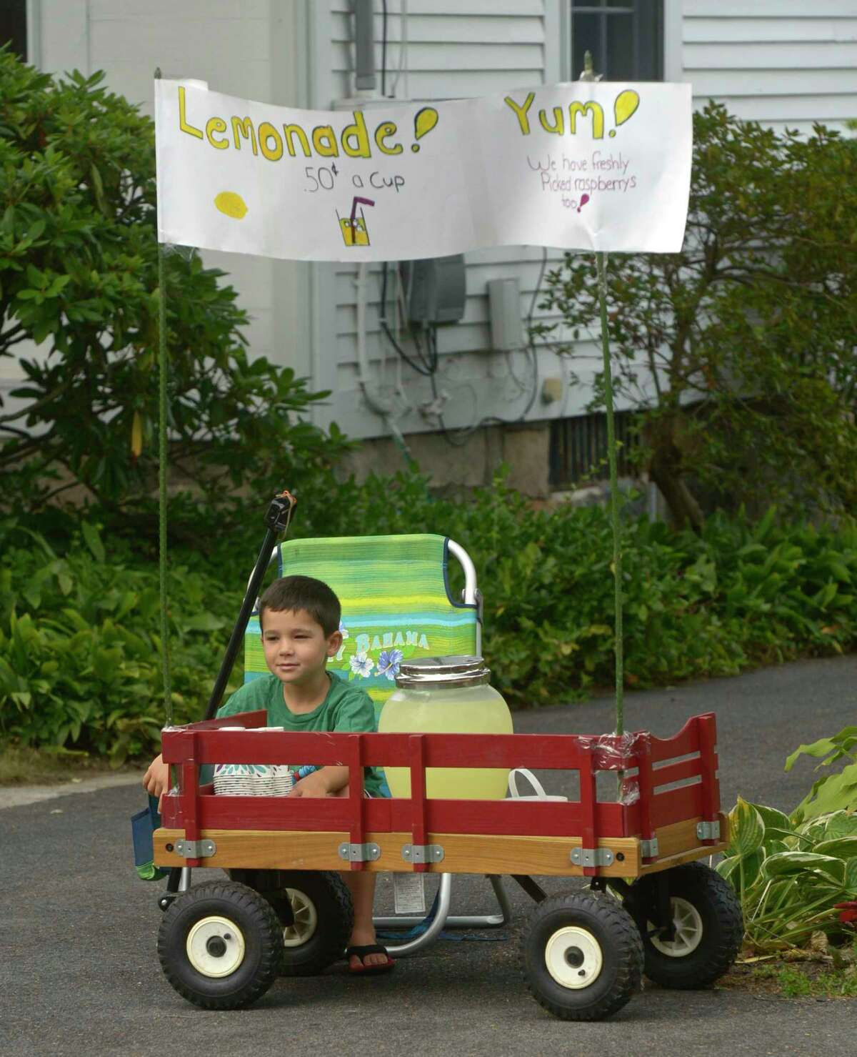 Jake Ragan, 7, of Newtown, mans a lemonade stand at the 2019 Newtown Labor Day Parade, Monday, September 2, 2019, in Newtown, Conn.