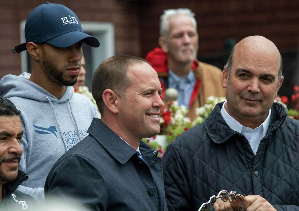 Chad Brown, left is crowned leading trainer for the 2019 meeting by senior vice president of racing operations Martin Panza at the Saratoga Race Course Monday Sept. 2, 2019 in Saratoga Springs, N.Y. Photo Special to the Times Union by Skip Dickstein