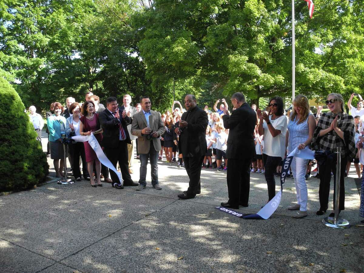 Cutting the ribbon to celebrate the opening of Our Lady of Fatima Catholic Academy are, from left, Wilton Library Executive Director Elaine Tai-Lauria, Selectwoman Lori Bufano, state Rep. Gail Lavielle, Dr. Steven Cheeseman, superintendent of schools for the Diocese of Bridgeport, Kevin Vallerie, president of Our Lady of Fatima's school board, Father Reggie Norman, pastor of Our Lady of Fatima Church, Bishop Frank Caggiano of the Diocese of Bridgeport, and parents Clara Tavera-Davis, Liz Halpin, and Mara Fleming. The ribbon-cutting took place Aug. 30, 2019, in Wilton, Conn.