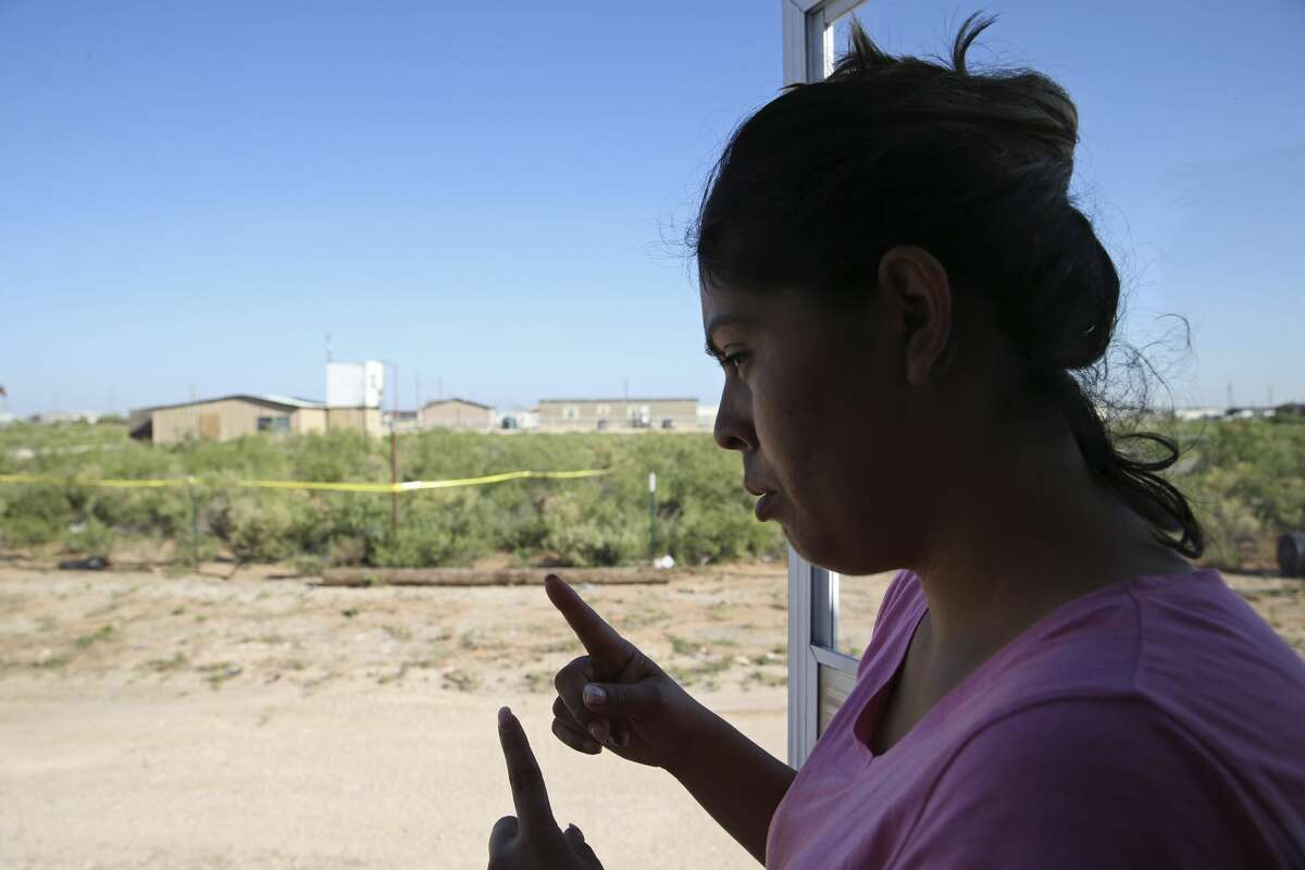 Veronica Alonzo, 29, talks about interactions with her neighbor, Seth Ator, 36, at their West Odessa, Texas neighborhood, Monday, Sept. 2, 2019. Ator lived in a aluminum shack, background, without electricity or running water in West Odessa. He is suspected in killing seven and injuring 22 people in a shooting rampage that started on IH-20 between Odessa and Midland, Texas, Saturday. Alonzo said that one time, Ator went to her trailer home with a rifle and complained about a trash issue.