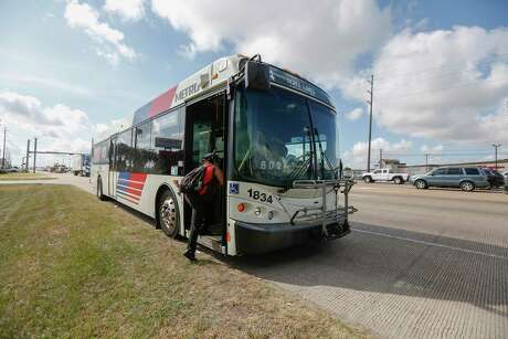 A passenger hops aboard a 44 Acres Home route bus near Old Bammel North Houston Road and Texas 249 on Aug. 12. Among proposed improvements to Metropolitan Transit Authority service is improved stops along major routes, such as the 44 Acres Homes.
