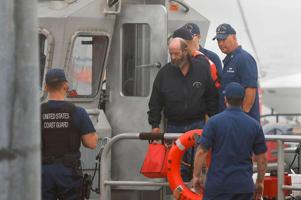 One of the crew members from the dive boat that caught fire and sank is brought back to the U.S. Coast Guard station in Oxnard on Sept. 2, 2019. At least 34 people are missing after a dive boat caught on fire and sank off Santa Cruz Island on a dive trip. Five crew members who were awake and on deck survived. (Carolyn Cole/Los Angeles Times/TNS)