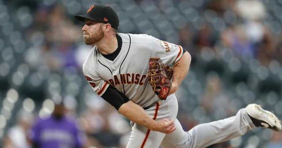 San Francisco Giants relief pitcher Sam Coonrod works against the Colorado Rockies in the ninth inning of the Giants' 19-2 win in Denver earlier this season. Photo: Associated Press
