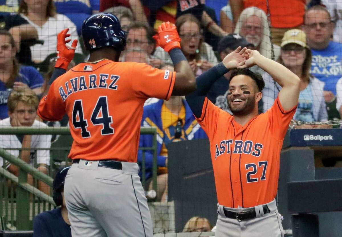 Houston Astros' Yordan Alvarez is congratulated after hitting a home run during the sixth inning of a baseball game against the Milwaukee Brewers Monday, Sept. 2, 2019, in Milwaukee. (AP Photo/Morry Gash)
