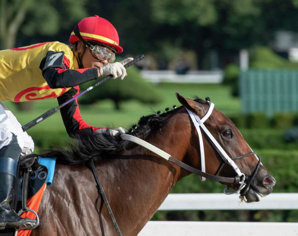 Jose Ortiz who has been crowned leading jockey for the 2019 meeting holds his index finger up showing the #1 after winning the 115th running of The Runhappy Hopeful on Basin at the Saratoga Race Course Monday Sept. 2, 2019 in Saratoga Springs, N.Y. Photo Special to the Times Union by Skip Dickstein