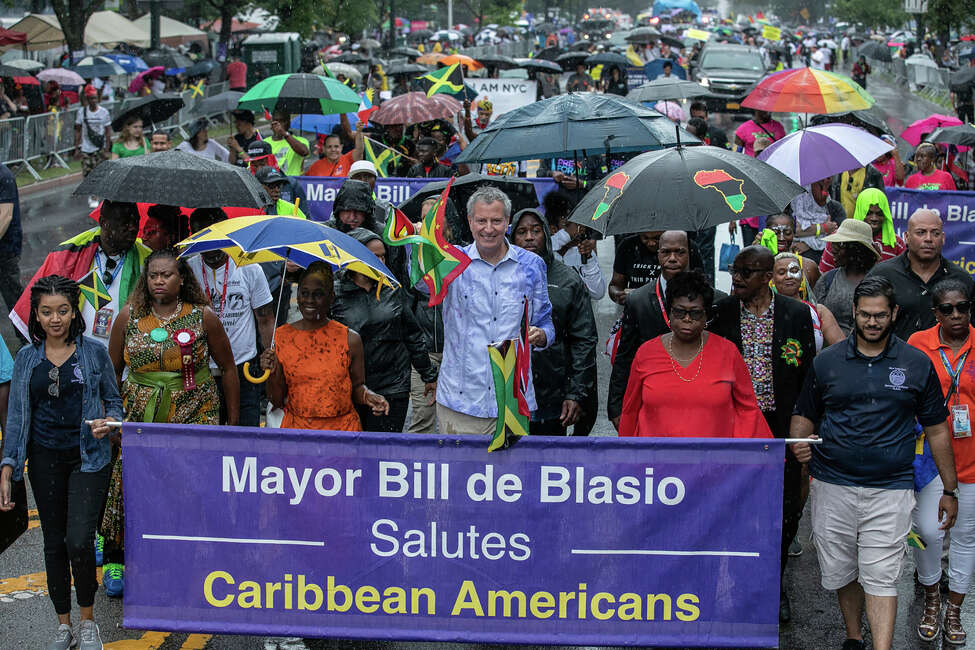 Mayor Bill de Blasio participates during the West Indian American Day Parade in the Brooklyn borough of New York, Monday, Sept. 2, 2019. (AP Photo/Jeenah Moon)