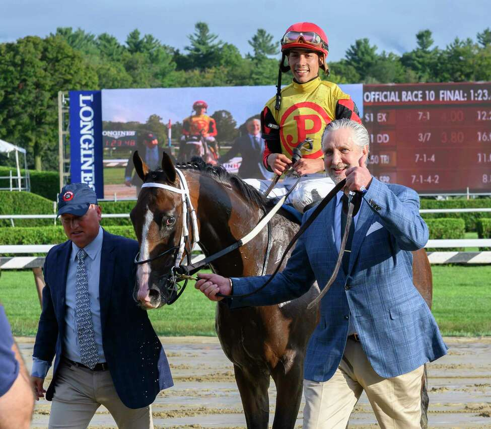 Jose Ortiz who has been crowned leading jockey for the 2019 meeting is all smiles after winning the 115th running of The Runhappy Hopeful on Basin is lead to the winner?•s circle by owner Terry Green, right and assistant trainer Scott Blasi at the Saratoga Race Course Monday Sept. 2, 2019 in Saratoga Springs, N.Y. Photo Special to the Times Union by Skip Dickstein