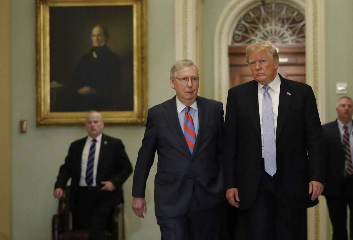 President Donald Trump, right, walks with Senate Majority Leader Mitch McConnell, a Republican from Kentucky, before attending the weekly Senate luncheons on Capitol Hill in Washington, D.C., U.S., on Tuesday, May 15, 2018. TrumpA nominatedA Gordon Hartogensis, a self-described entrepreneur who is McConnellA and Secretary of TransportationA Elaine Chao's brother-in-law, to lead the federal agency that pays worker pensions when employers terminate their retirement plans. Photographer: Aaron P. Bernstein/Bloomberg