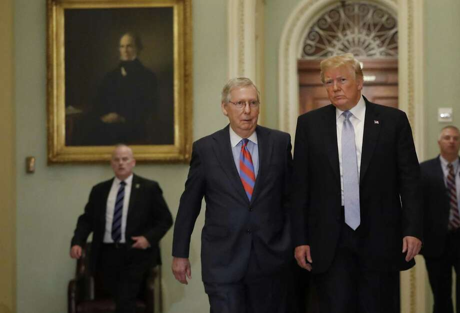 President Donald Trump, right, walks with Senate Majority Leader Mitch McConnell, a Republican from Kentucky, before attending the weekly Senate luncheons on Capitol Hill in Washington, D.C., U.S., on Tuesday, May 15, 2018. TrumpA nominatedA Gordon Hartogensis, a self-described entrepreneur who is McConnellA and Secretary of TransportationA Elaine Chao's brother-in-law, to lead the federal agency that pays worker pensions when employers terminate their retirement plans. Photographer: Aaron P. Bernstein/Bloomberg Photo: Aaron P. Bernstein / © 2018 Bloomberg Finance LP