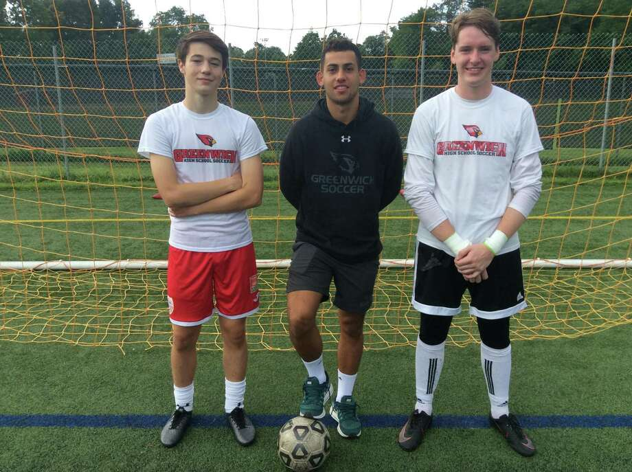 From left to right, Max Pisacreta, Davi Pedreiro and Padraig Colligan are senior captains on the Greenwich boys soccer team. Photo: David Fierro /Hearst Connecticut Media