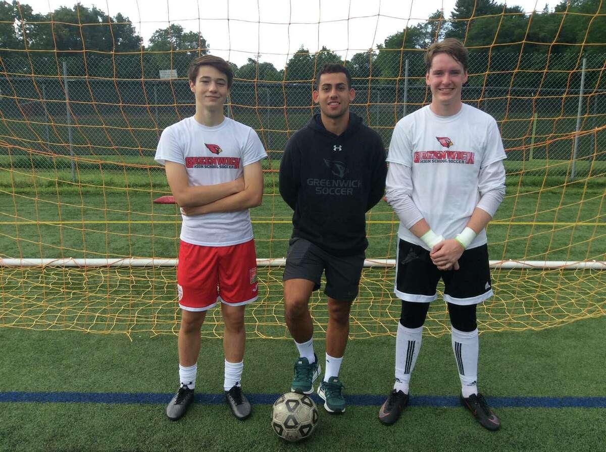 From left to right, Max Pisacreta, Davi Pedreiro and Padraig Colligan are senior captains on the Greenwich boys soccer team.