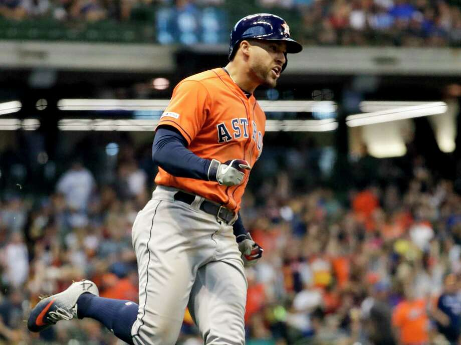 George Springer celebrates as he rounds the bases after his tiebreaking home run during the 10th inning Monday in Milwaukee that led to the Astros' 3-2 win over the Brewers. Photo: Morry Gash, Associated Press / Copyright 2019 The Associated Press. All rights reserved.