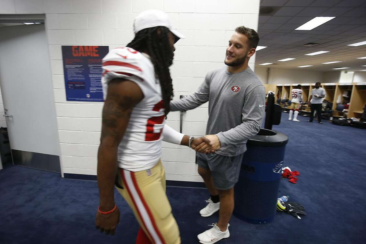 DENVER, CO - AUGUST 19: Richard Sherman #25 and Nick Bosa #97 of the San Francisco 49ers celebrate in the locker room following the game against the Denver Broncos at Mile High Stadium on August 19, 2019 in Denver, Colorado. The 49eres defeated the Bronco