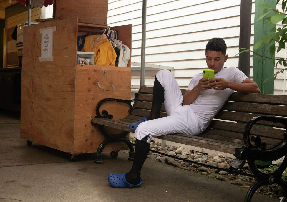 Jockey Eric Cancel spends some time on his phone in the jockey's area on Monday, Sept. 2, the final day of the 2019 meet at Saratoga Race Course in Saratoga Springs, N.Y. (Jenn March, Special to the Times Union )