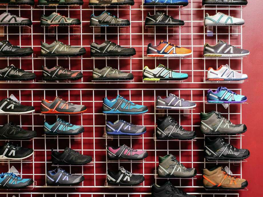 Shoes on display at the offices of Xero Shoes in Broomfield, Colo., Aug. 29, 2019. President Donald Trump's trade war is pressuring American companies to leave China, but many won't be able to move their supply chains home.  (Benjamin Rasmussen/The New York Times) Photo: BENJAMIN RASMUSSEN / Benjamin Rasmussen/The New York Times / NYTNS