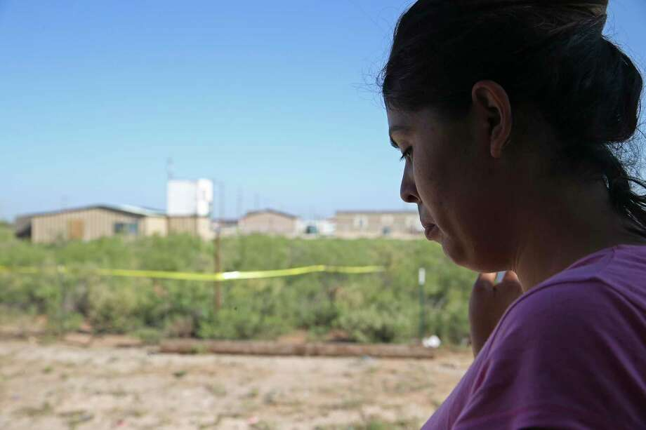 Veronica Alonzo, 29, talks about interactions with her neighbor, Seth Ator, 36, at their West Odessa, Texas neighborhood, Monday, Sept. 2, 2019. Ator lived in a aluminum shack, background, without electricity or running water in West Odessa. He is suspected in killing seven and injuring 22 people in a shooting rampage that started on IH-20 between Odessa and Midland, Texas, Saturday. Alonzo said that one time, Ator went to her trailer home with a rifle and complained about a trash issue. Photo: Jerry Lara, Staff / Staff Photographer / © 2019 San Antonio Express-News
